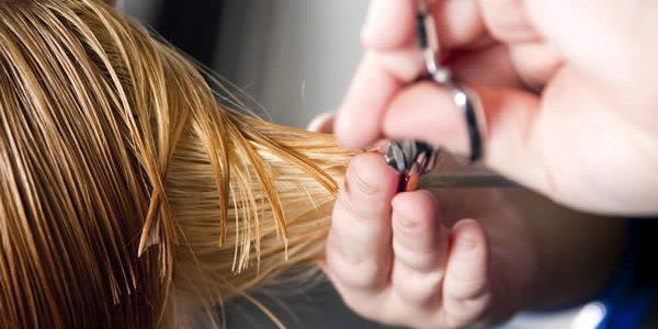 Hands cutting hair